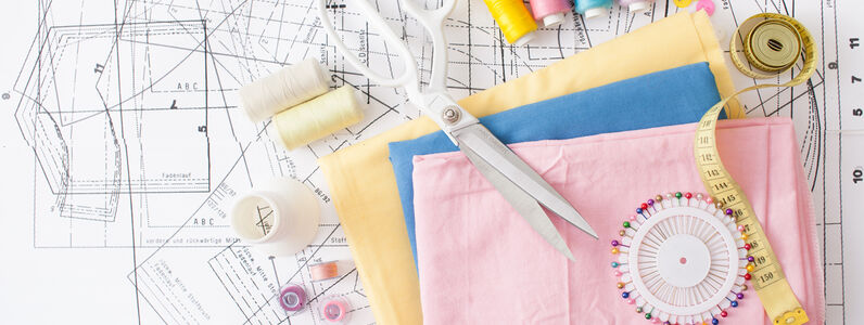 Sewing,Supplies,On,A,White,Wooden,Table:,Sewing,Thread,,Scissors,